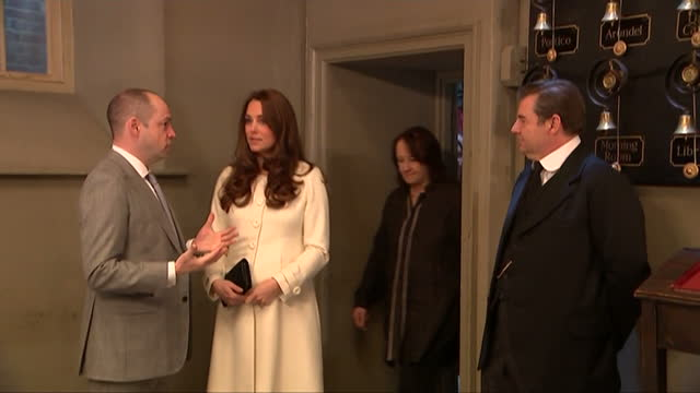interior shots of catherine, duchess of cambridge speaking to actor brendan coyle nad downton abbey series creator julian fellowes on part of the... - julian fellowes stock videos & royalty-free footage