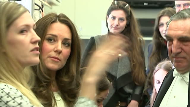 Interior shots of Catherine Duchess of Cambridge speaking to actor Jim Carter and costume designer Anna Robbins in the wardrobe department during a...