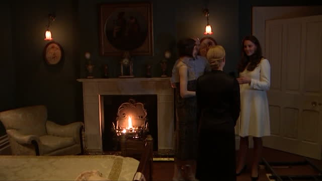 Interior shots of Catherine Duchess of Cambridge speaking to Downton Abbey cast members Michelle Dockery and Joanne Froggartt on set>> on March 12...