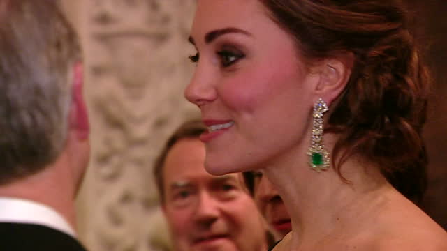 Interior shots of Catherine Duchess of Cambridge speaking to guests at the St Andrews 600th Anniversary Dinner including Vogue magazine Editor Anna...