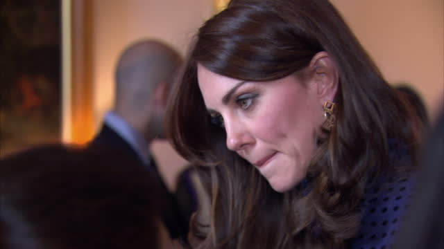 interior shots of catherine duchess of cambridge speaking to guests at a reception at kensington palace meeting students from india and bhutan>> on... - kensington palace video stock e b–roll