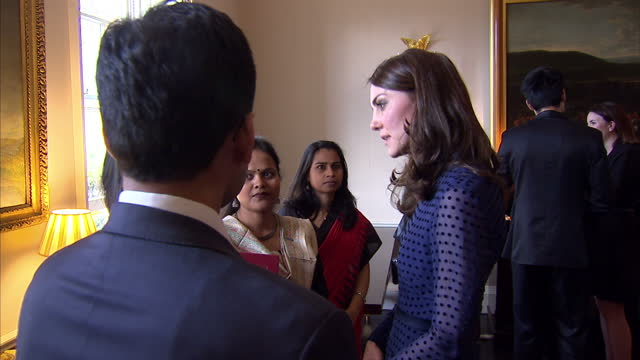 interior shots of catherine duchess of cambridge speaking to guests at a reception t kensington palace meeting with students and members of the... - guest stock videos and b-roll footage