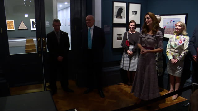 Interior shots of Catherine Duchess of Cambridge unveiling a plaque and signing a visitors book at the Victoria and Albert Museum on 10 October 2018...