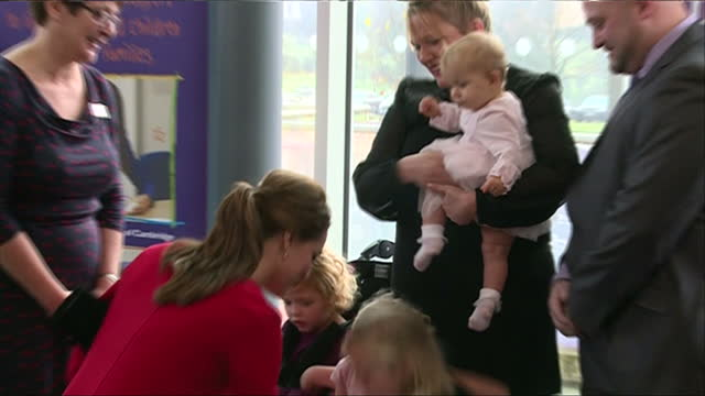 interior shots of catherine, duchess of cambridge walking with east anglia children's hospices chief executive graham butland and meeting with... - east anglia stock-videos und b-roll-filmmaterial