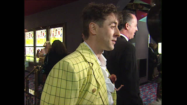 interior shots of celebrities arriving for spice girls' movie premiere on 15 december 1997 in london, united kingdom - angus deayton stock videos & royalty-free footage