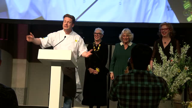 interior shots of celebrity chef jamie oliver speaking at a ceo cook-off event with ronni kahn, ceo ozharvest and camilla, duchess of cornwall stood... - jamie oliver stock videos & royalty-free footage