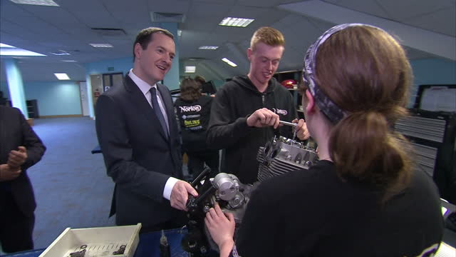 interior shots of chancellor george osborne arriving at norton motorcycles donington hall factory and meeting staff and apprentices>> on july 28 2015... - チャンセラー点の映像素材/bロール