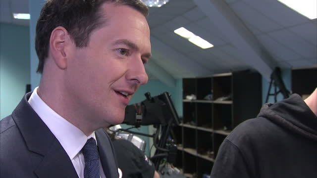 interior shots of chancellor george osborne speaking to staff and apprentices during a visit to norton motorcycles donington hall factory>> on july... - チャンセラー点の映像素材/bロール