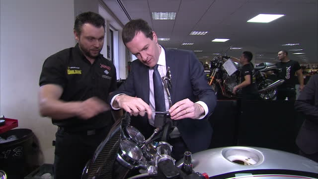 interior shots of chancellor george osborne trying his hand at assembling motorcycles during a visit to norton motorcycles donington hall factory>>... - チャンセラー点の映像素材/bロール
