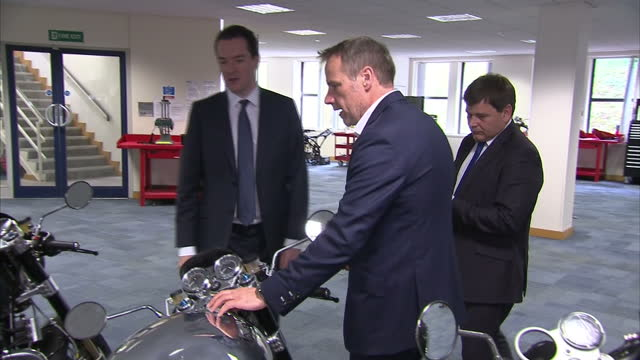 interior shots of chancellor george osborne viewing a collection of norton motorcycles on display during a visit to the donington hall factory>> on... - チャンセラー点の映像素材/bロール