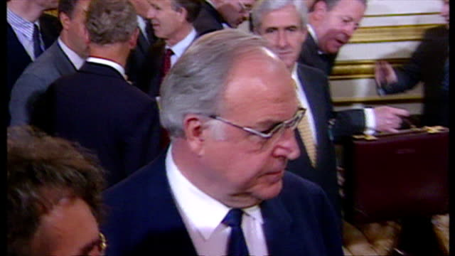 interior shots of chancellor helmut kohl mingling with others at a nato summit on july 05 1990 in london, england. - nato stock-videos und b-roll-filmmaterial