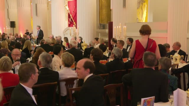 GBR: A group of climate change protesters have disrupted the Chancellor's speech at the annual Mansion House dinner.