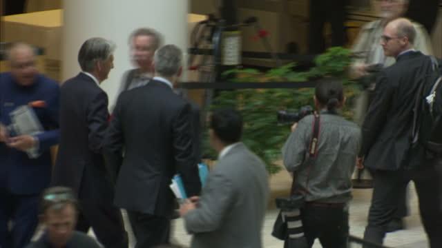 interior shots of chancellor philip hammond walking into the annual meeting of the international monetary fund on 14 october 2017 in washington dc,... - 年次総会点の映像素材/bロール