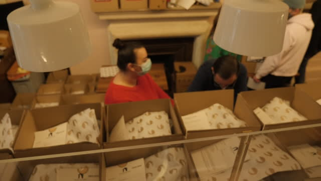 interior shots of chefs packing diy meal kits into boxes in the kitchen of the bocca di lupo restaurant on 12 february 2021 in london, united kingdom - diy stock videos & royalty-free footage