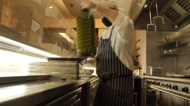 interior shots of chefs preparing and packing diy meal kits into boxes in the kitchen of the bocca di lupo restaurant on 12 february 2021 in london,... - diy stock videos & royalty-free footage