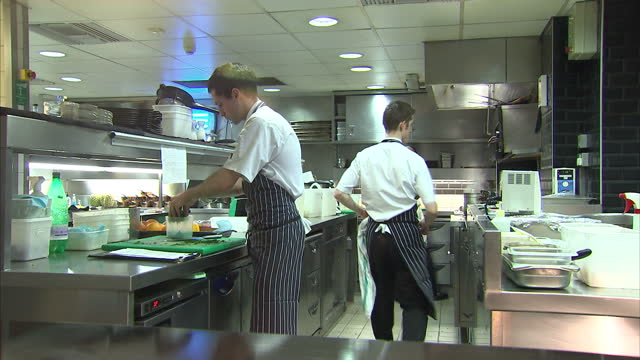 interior shots of chefs working preparing fennel and pastries in the kitchen of marcus wareing's restaurant at the berkeley marcus wareing at the... - commercial kitchen stock videos & royalty-free footage