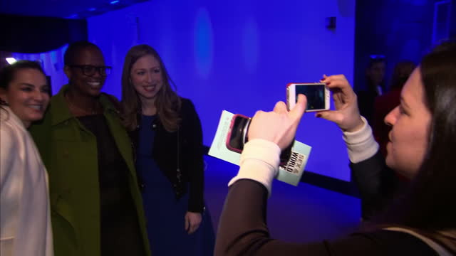 interior shots of chelsea clinton being greeted by sky news reporter having her photo taken with various people backstage and taking her seat for an... - backstage stock videos & royalty-free footage