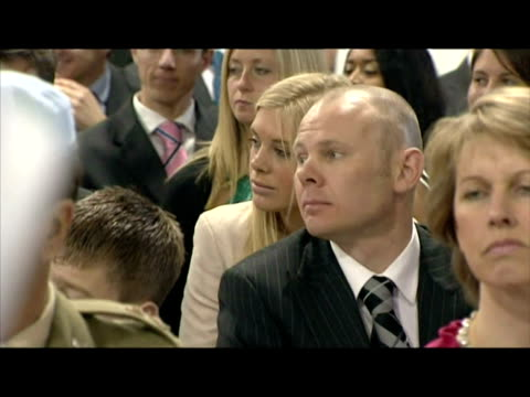 vidéos et rushes de interior shots of chelsy davy, prince harry's girlfriend, in the audience as prince harry receives his wings from prince charles. sky news: royal... - 50 secondes et plus
