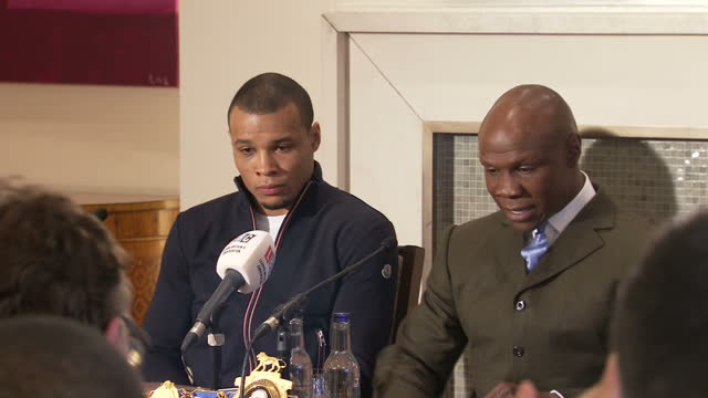 interior shots of chris eubank and chris eubank jr. sitting down to give a press conference, and chris eubank speaking about being inundated with... - chris eubank sr stock videos & royalty-free footage