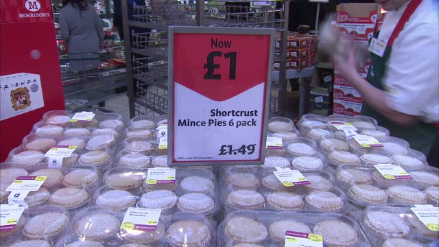 interior shots of christmas mince pies being laid out in morrisons supermarket for public to buy. panic buying at supermarkets for christmas on... - dessert stock videos & royalty-free footage