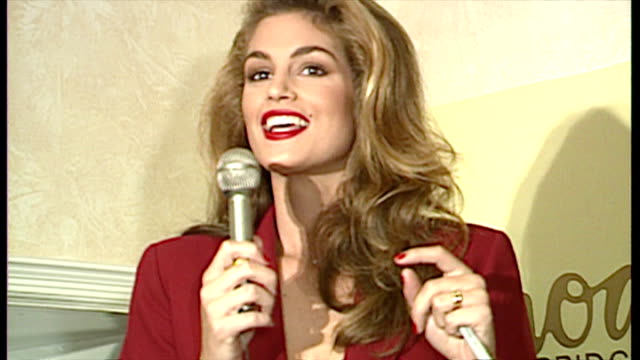 interior shots of cindy crawford preparing to sign autographs and welcoming fans during a revlon launch event at harrods.>> on october 01, 1992 in... - cindy crawford stock videos & royalty-free footage