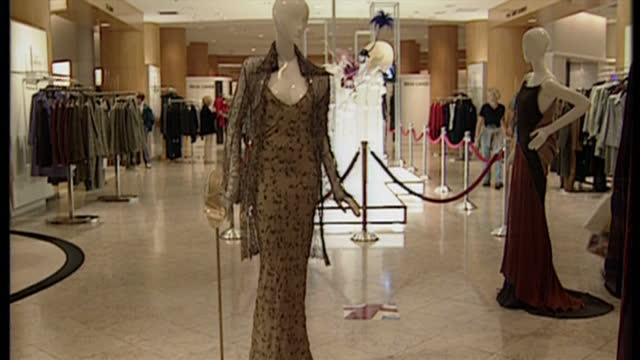 Interior shots of clothing on display from Julian Macdonald McQueen and Zandra Rhodes and manequins wearing elaborate hats and fascinators at Saks...