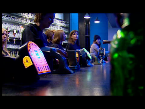 interior shots of clubbers ordering drinks at the bar. interior shots of clubbers dancing. all music requires additional clearance. sky news... - 1 minute or greater stock videos & royalty-free footage