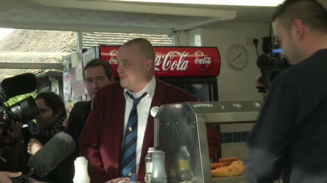 interior shots of comedian al murray buying fish and chips whilst campaigning in thanet on march 13, 2015 in sandwich, united kingdom. - comedian stock videos & royalty-free footage