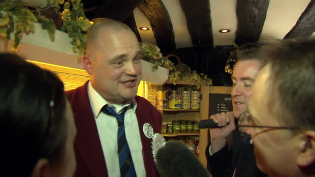 interior shots of comedian al murray in a french delicatessen in thanet buying a cheese and taking questions from journalists while launching his... - al murray stock videos & royalty-free footage