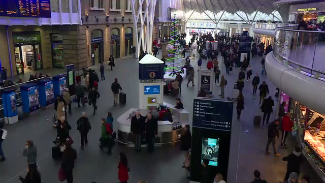 Interior shots of commuters walking about King's Cross train station on 19th December 2017 London England