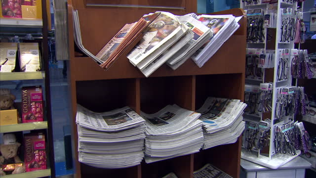 Interior shots of copies of The Washington Post on sale in a branch of Hudson News newsagents' on day of its sale to Amazon founder Jeff Bezos on...
