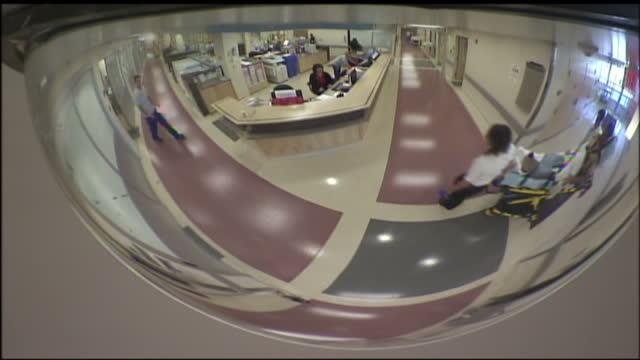 interior shots of corridors and a stretcher being moved through the presbyterian hospital corridors on january 1 2008 in albuquerque united states - väntrum bildbanksvideor och videomaterial från bakom kulisserna