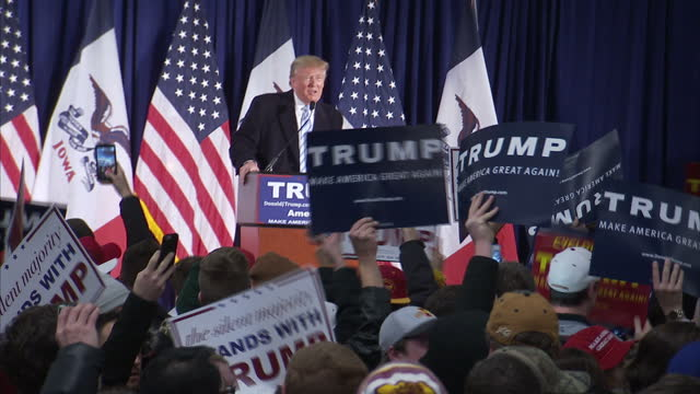 Interior shots of crowds at an Iowa Donald Trump rally with trump at podium chanting 'USA USA' as a noisy protester is ejected on January 19 2016 in...