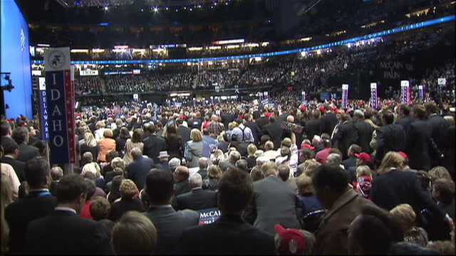 Interior shots of crowds cheering John McCain and Sarah Palin in convention hall during his keynote speech to the Republican Party prior to the 2008...