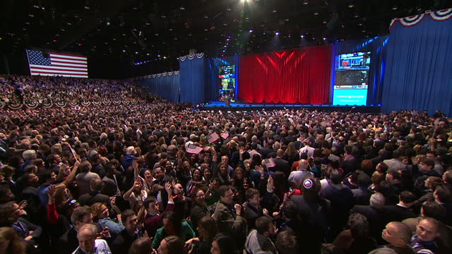 vídeos y material grabado en eventos de stock de interior shots of crowds of supporters at the obamabiden election night rally at mccormick place in chicago celebrating as results are announced... - 2012