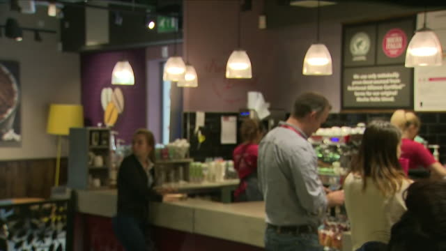 interior shots of customers being served coffee and other items by baristas at a costa coffee branch on 31 august 2018 in dunstable united kingdom - markenname stock-videos und b-roll-filmmaterial