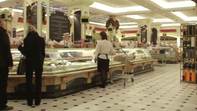interior shots of customers browsing goods for sale inside harrods department store in london england uk on december 10th 2015 shots wide shots pan... - food court stock videos and b-roll footage