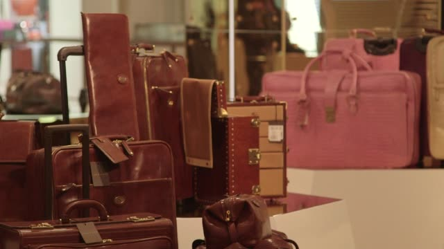 interior shots of customers browsing goods for sale inside harrods department store in london england uk on december 10th 2015 shots close up shots... - バッグ点の映像素材/bロール
