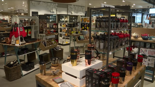 Interior shots of customers browsing goods in the kitchen and homeware departments in a John Lewis department store the menswear department and...