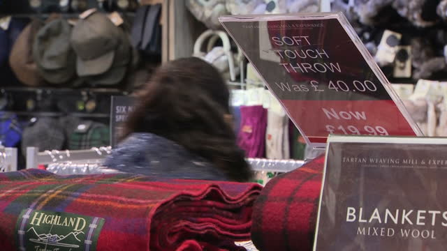 interior shots of customers browsing in a shop selling tartan accessories and woollen goods including shots of scottish themed novelty souvenirs on... - tartan stock videos & royalty-free footage