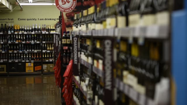 interior shots of customers browsing merchandise inside a bevmo liquor store in san francisco california on april 7th 2015 shots wide shot of a... - liquor store stock videos and b-roll footage