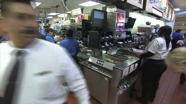 interior shots of customers ordering and eating mcdonald's fast food in a mcdonald's restaurant on november 1 2011 in chicago united states - mcdonald's stock videos & royalty-free footage