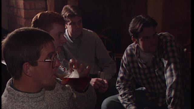 interior shots of customers watching princess diana's interview on the bbc panorama tv programme in a pub, and vox pops of customers watching,... - 不祥事点の映像素材/bロール