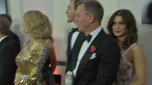 Interior shots of Daniel Craig and Rachel Weisz waiting in line to meet the Royal Family at the Royal World Premiere of 'Spectre' at Royal Albert...