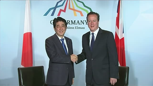 interior shots of david cameron meeting japanese prime minister shinzo abe and the two seated chatting for photocall at the g7 summit in bavaria on... - 座る点の映像素材/bロール