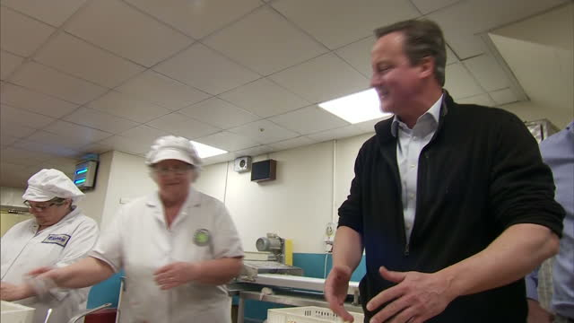 interior shots of david cameron meeting staff and touring a catering company whilst campaigning for edward timpson on 12 may 2017 in nantwich, united... - ナントウィッチ点の映像素材/bロール