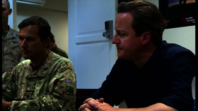 vídeos de stock, filmes e b-roll de interior shots of david cameron sat with army officials and soldiers one official unidentifiable david cameron meeting with army officials on july 18... - david cameron político