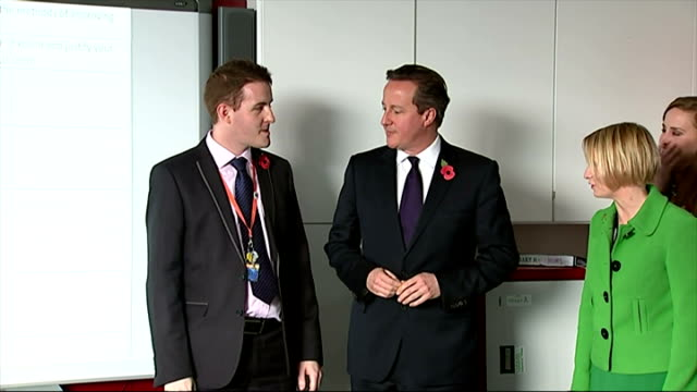 Interior shots of David Cameron walking into a school classroom and speaking to the pupils about voting on November 11 2014 in Strood England