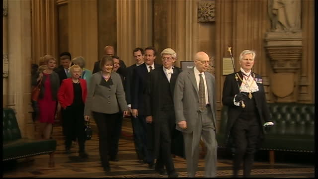 vidéos et rushes de interior shots of david leakey black rod walking through the lobby of the houses of common towards the commons chamber and then walking back... - 2015