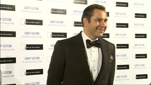 Interior shots of David Walliams arriving and posing for photo op at Grey Goose Vodka Winter Ball in aid of Elton John Aids Foundation charity David...